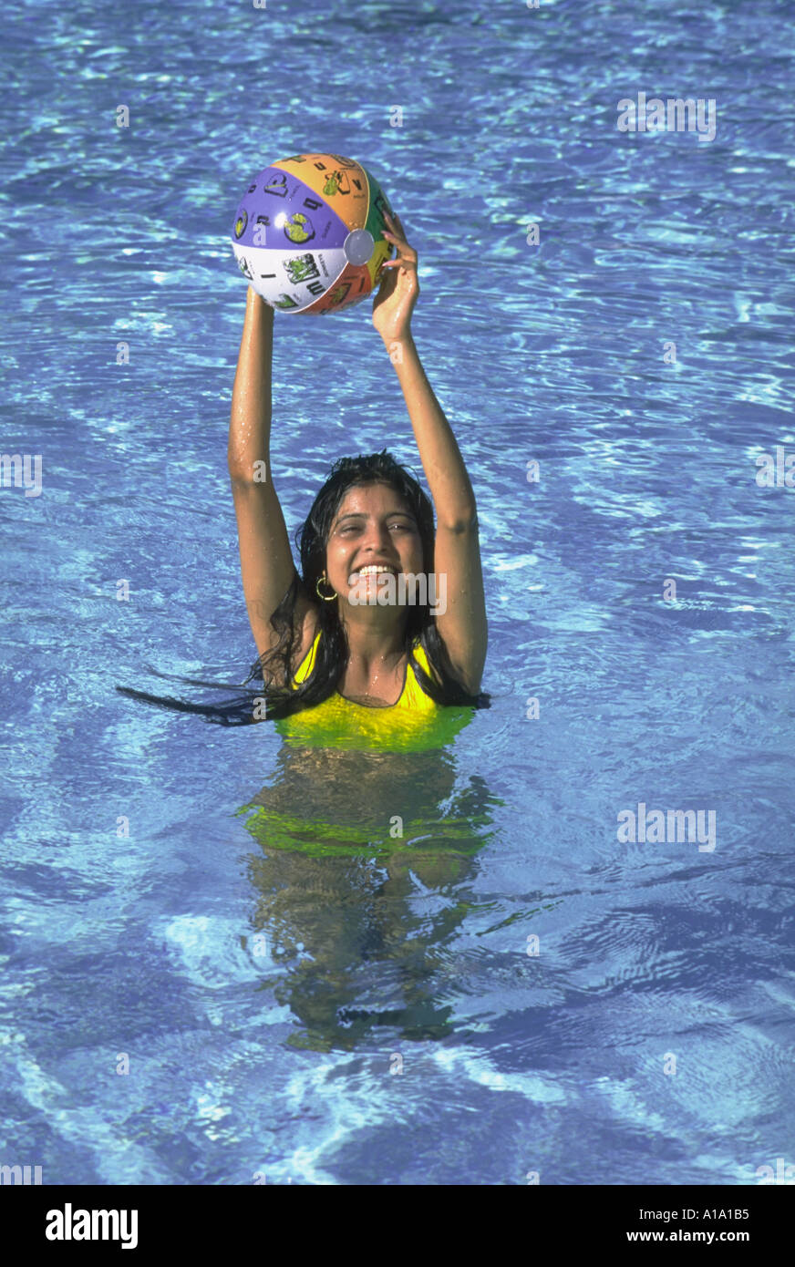 pool water with beach ball. Young Indian Woman Playing With Beach Ball In Swimming Pool Water