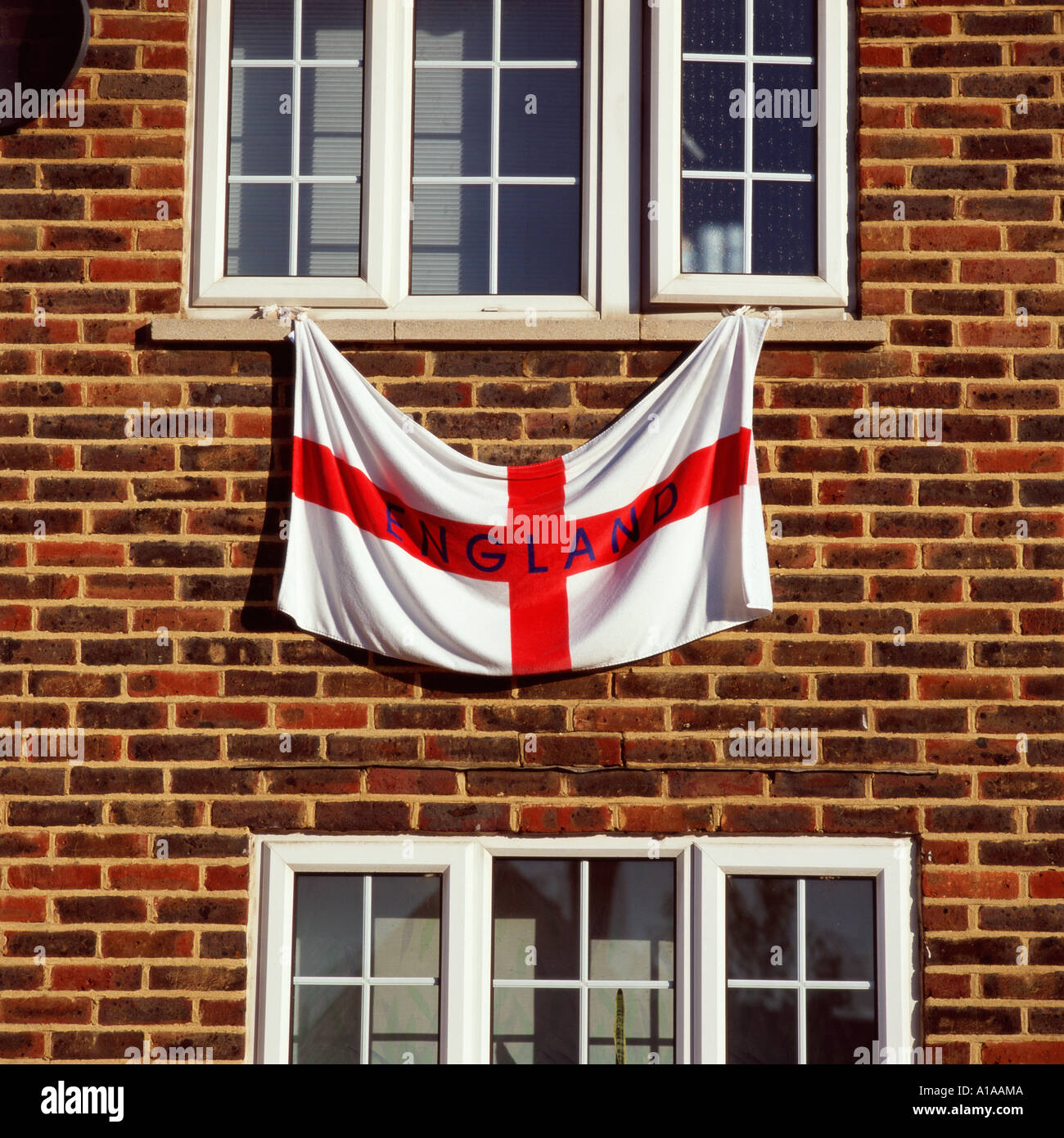 england flag hanging from a window stock photo royalty free image