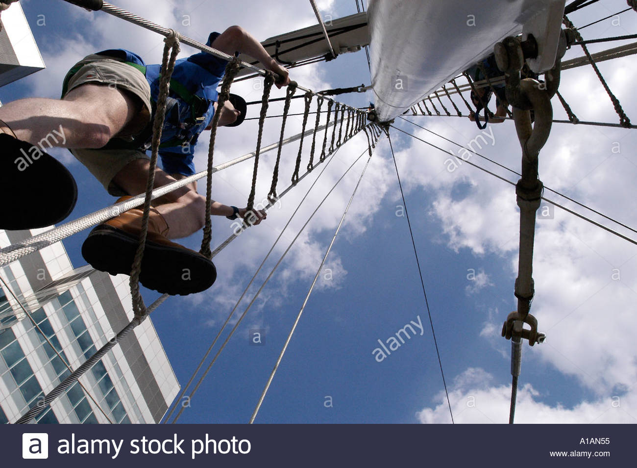 volunteer climb height sky ship boat rope ladder Stock Photo ... for Rope Ladder Ship  155sfw