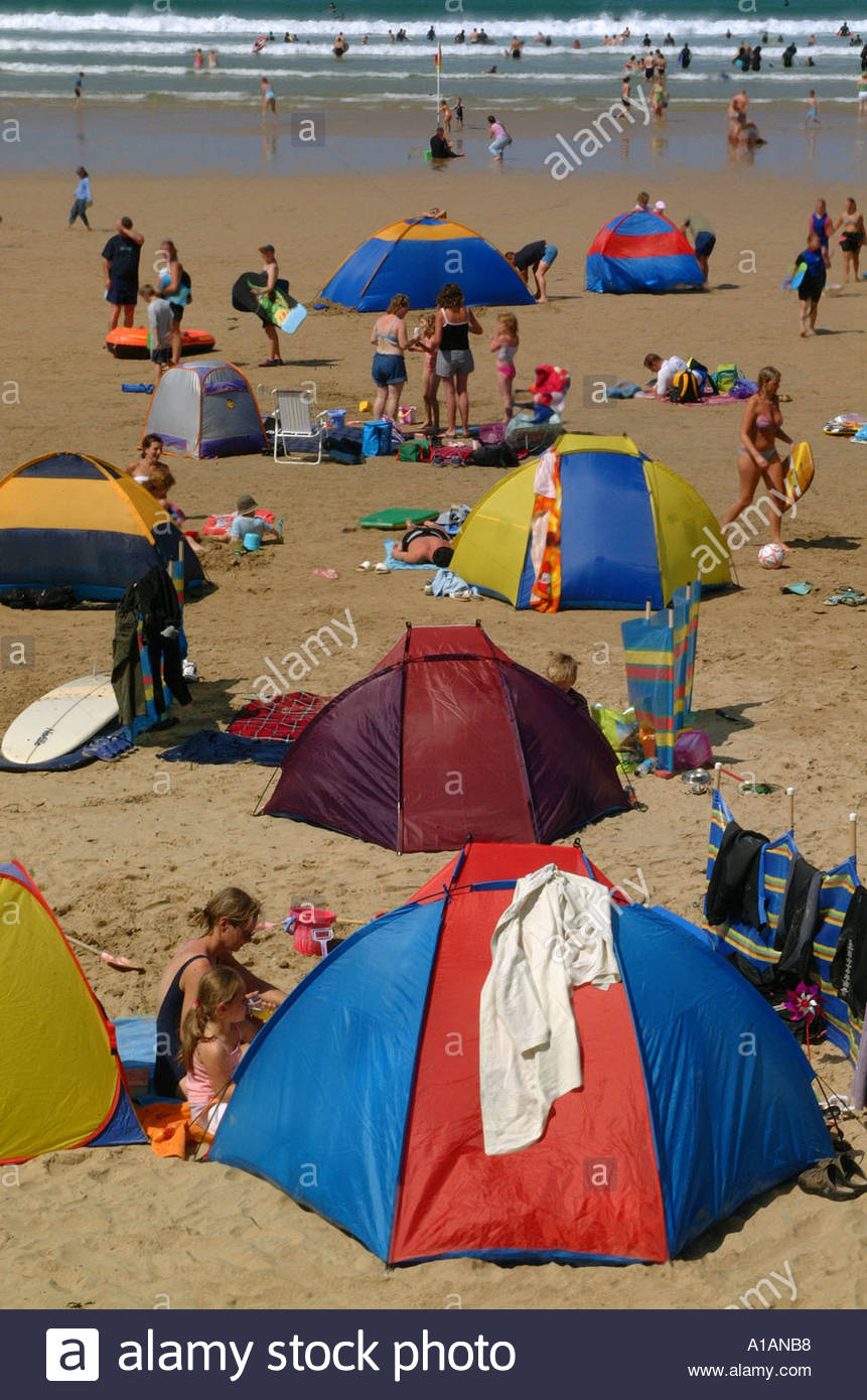 Brightly coloured beach tents windbreaks on Watergate Bay beach Cornwall popular surfing beach UK & Brightly coloured beach tents windbreaks on Watergate Bay beach ...