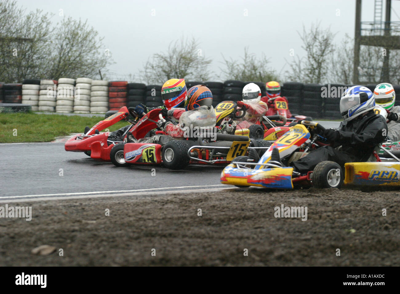 Crash in the wet during a mini max kart race at a wet Nutts Corner ...