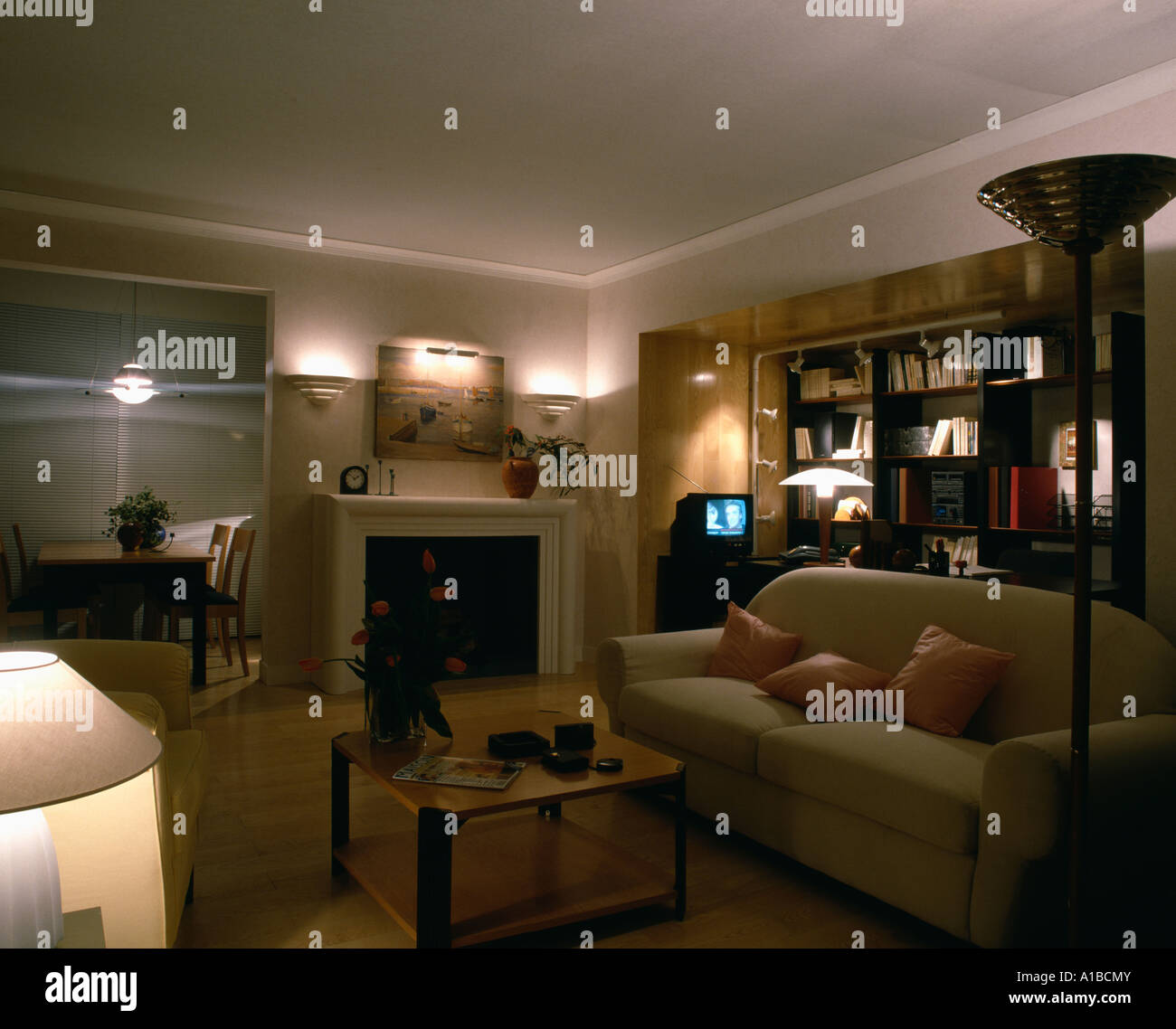 Lamps And Uplighters Above Fireplace In Modern Living Room