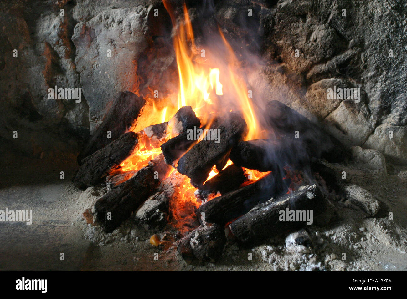 Flames coming from a burning peat turf fire in a traditional Irish ...