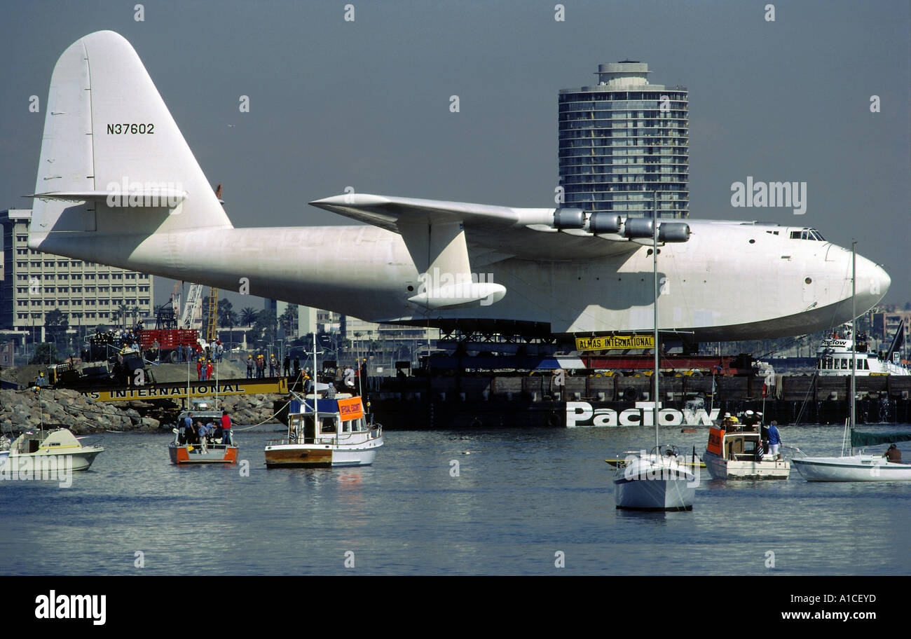 Sightseeing Boats And Official Escorts Follow The Towing Of The Spruce Goose In Long Beach California