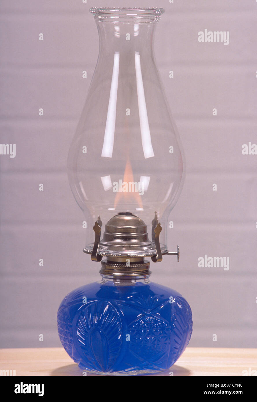 glass oil lamp with flame and blue oil in cut glass base white ...