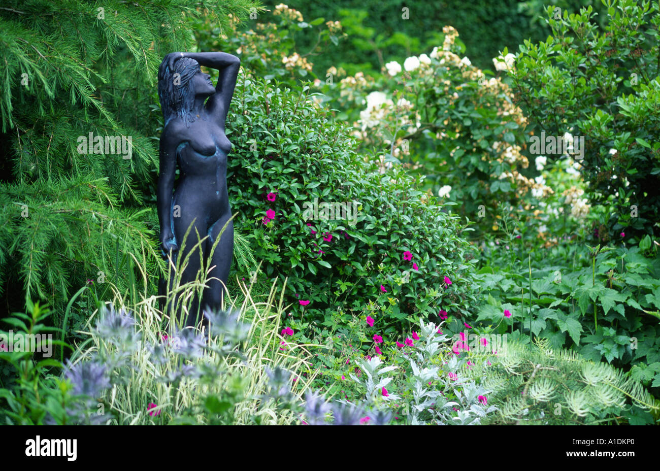 Stock Photo   Garden Statue Bronze Garden Statue Of A Naked Lady In A Bed  Of Willowherb