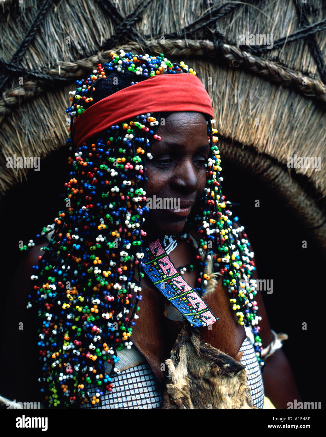 Zulu traditional dress in zulu kraal kwazulu natal - Stock Photo Zulu Woman With Traditional Head Dress Zululand Natal South Africa