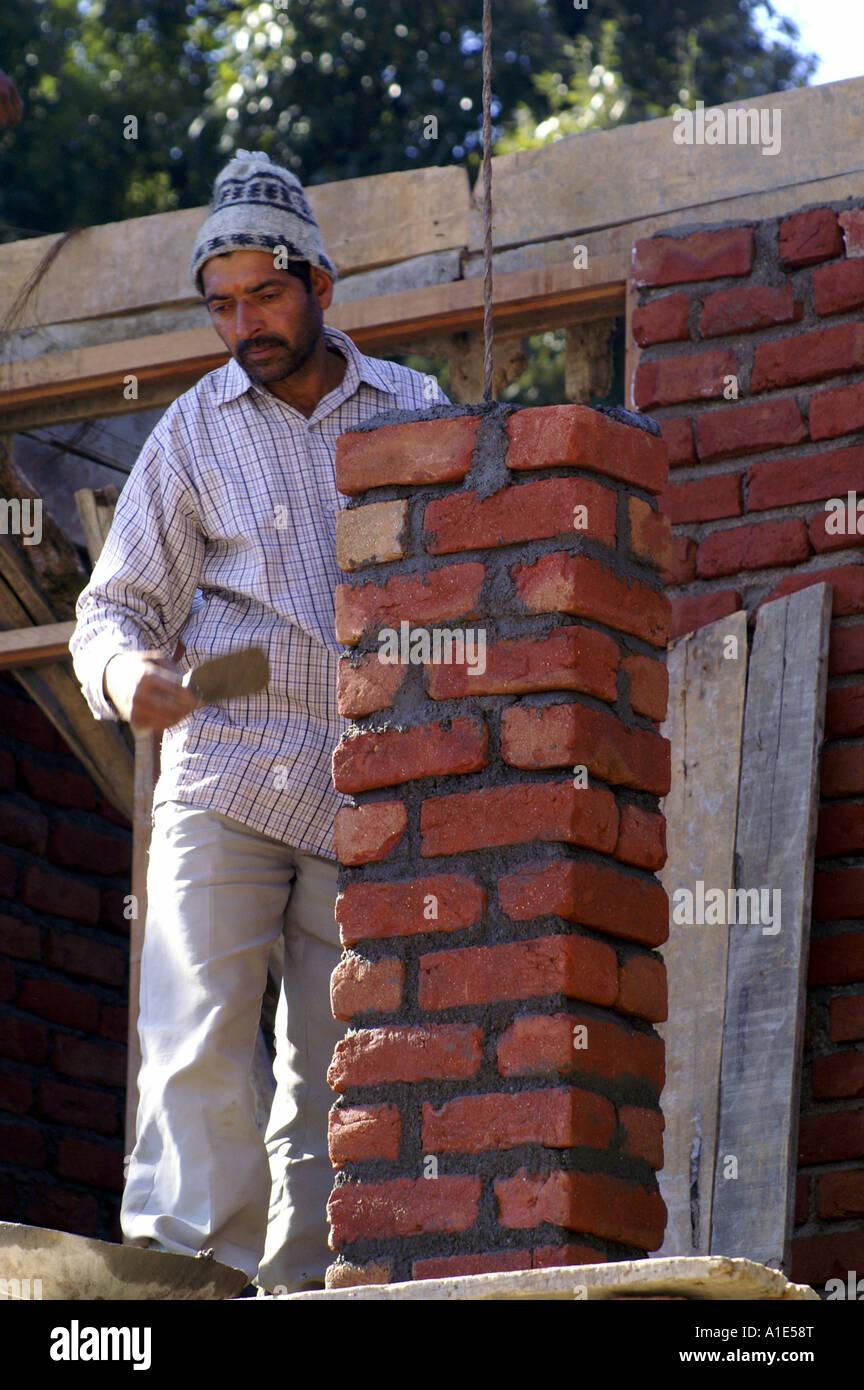 Indian Man Bricklayer Building Brick Wall At Construction Site Bhagsunag Village Northern India