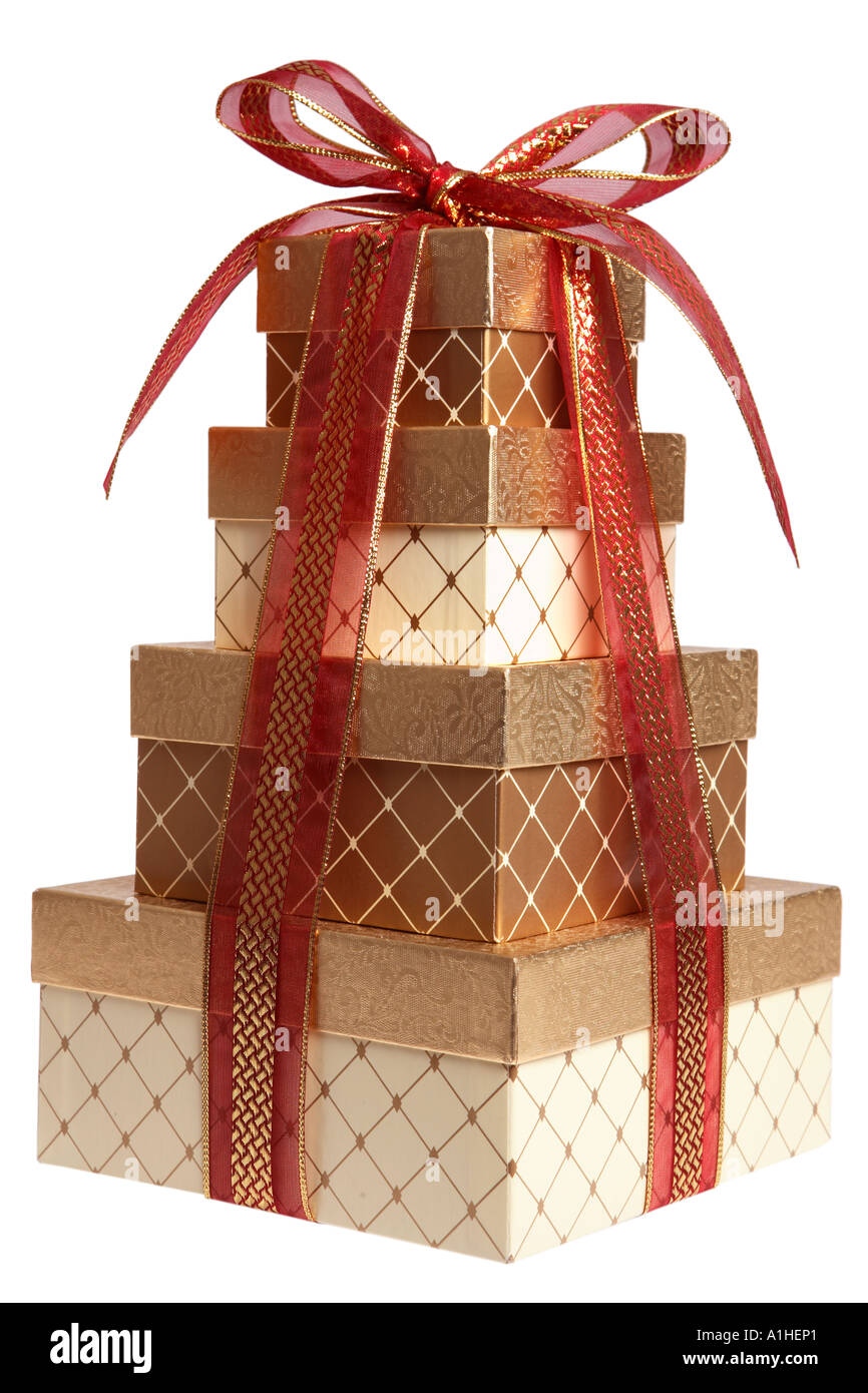 stack of christmas presents wrapped in gold and red stock photo