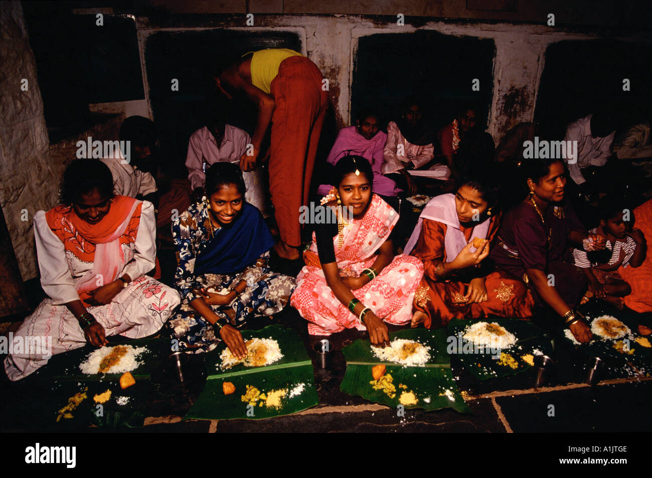Guests eating traditional food at a hindi wedding tamil for Aharam traditional cuisine of tamil nadu