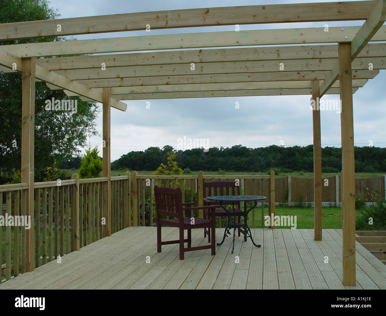Pergola over garden patio deck the decking and pergola are for Tanalised timber decking