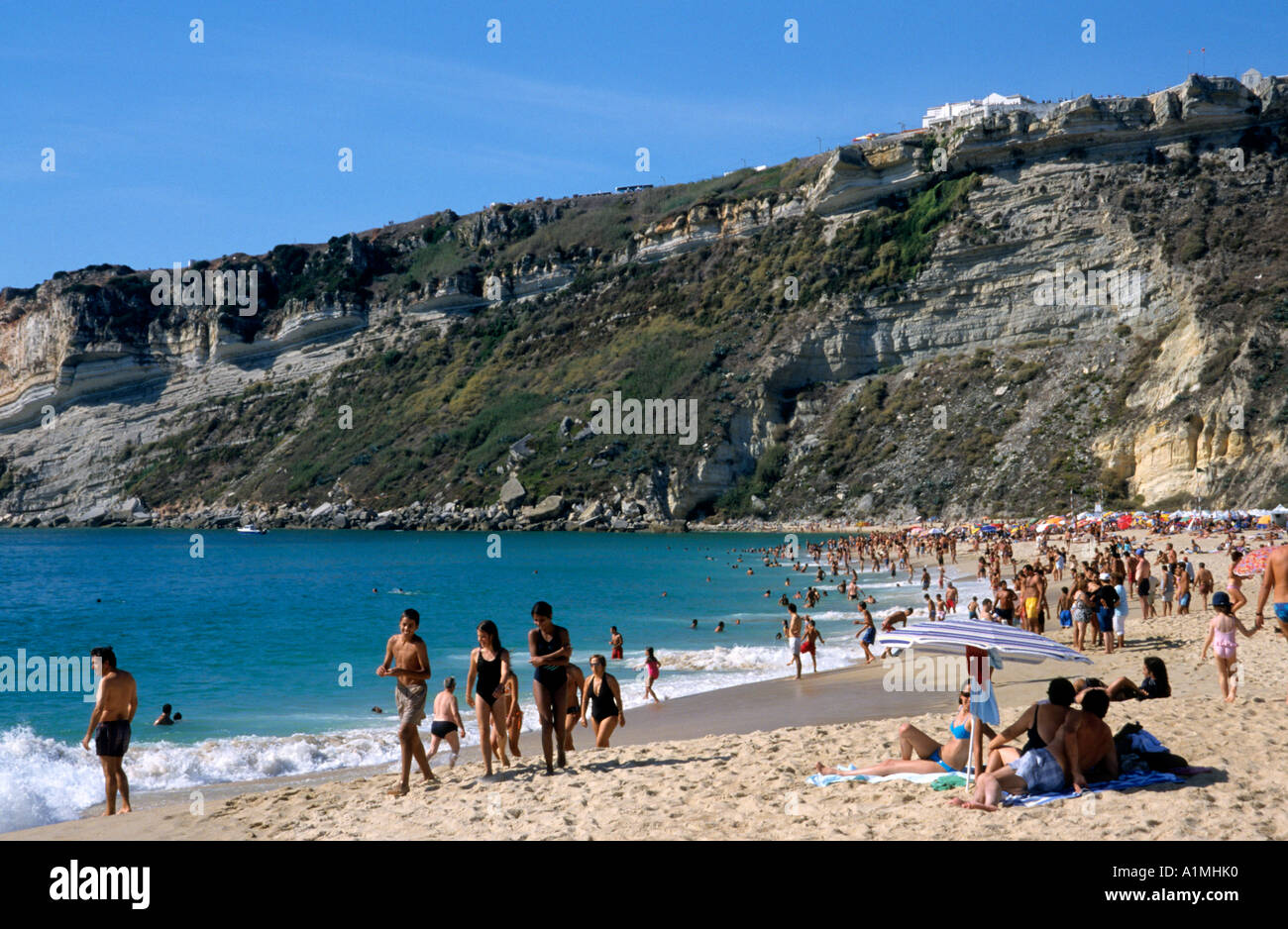 Rain Beach Emerald Coast Blue Sea Australia Ocean Summer: Nazare Beach Portugal Portugese Coast Sea Sand Stock Photo