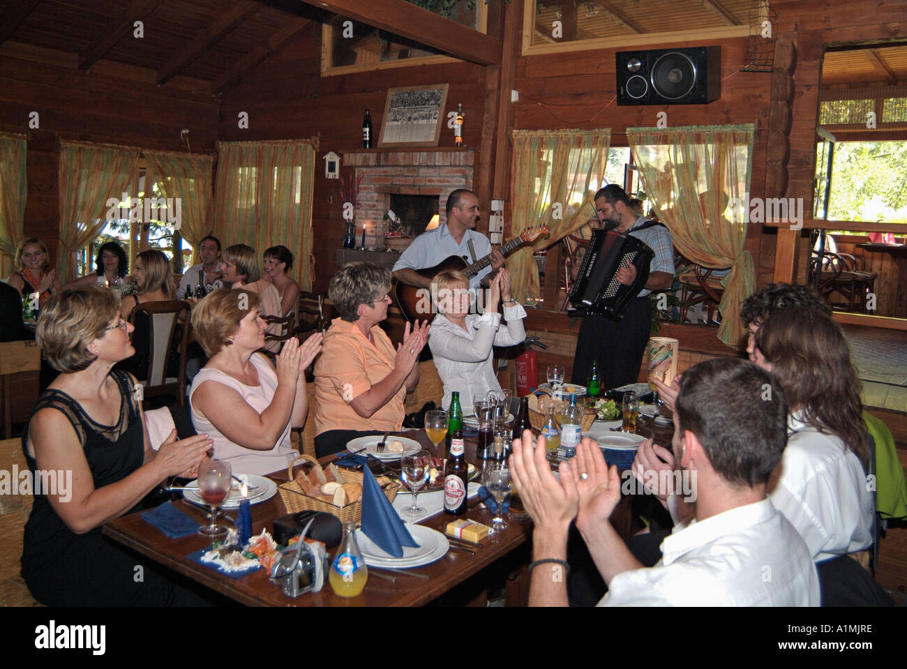 Family And Guests Sing Along To Traditional Folk Music At An Orthodox Wedding Reception