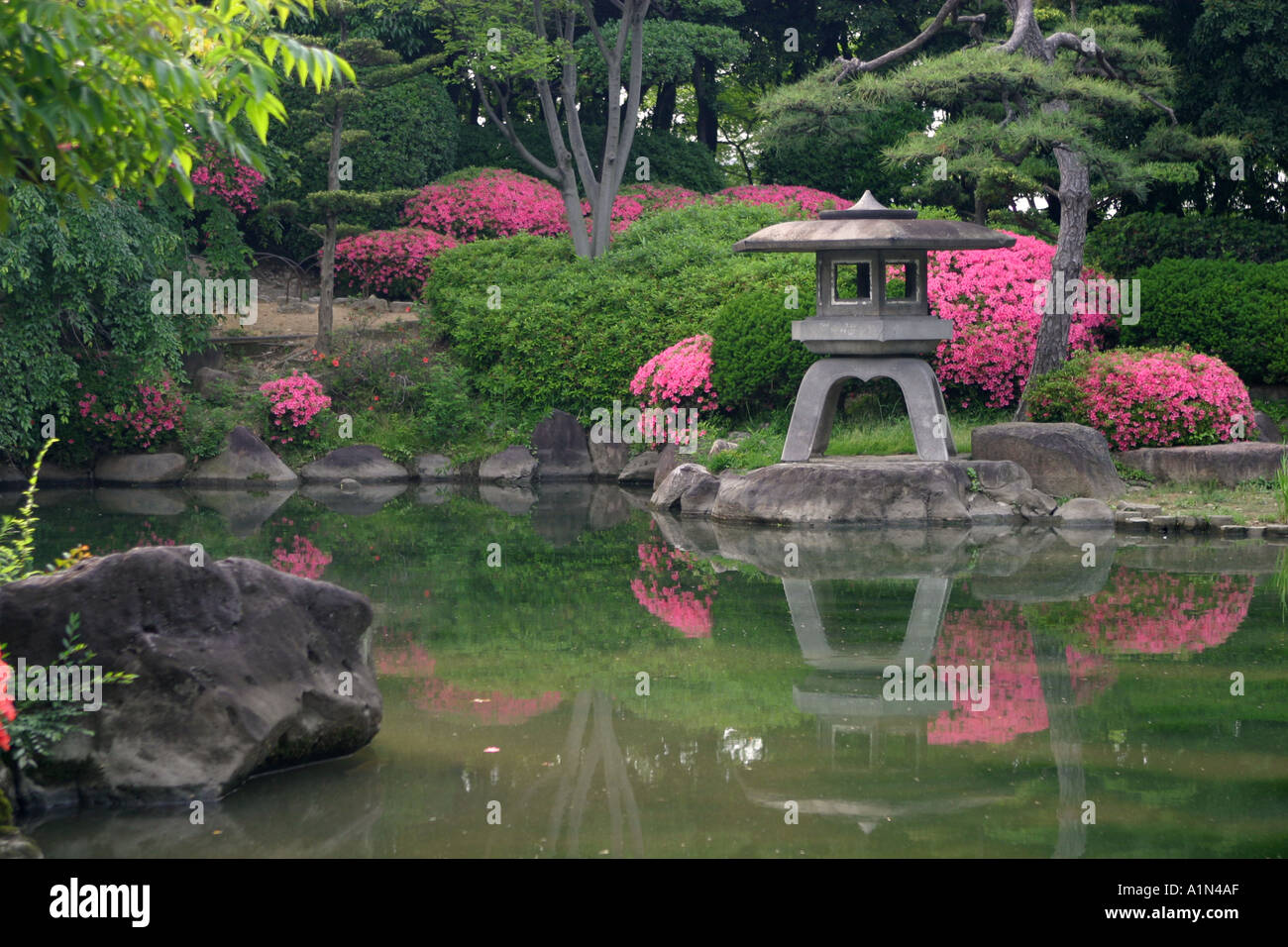 Stone lantern in a colourful traditional iconic japanese for Traditional japanese garden