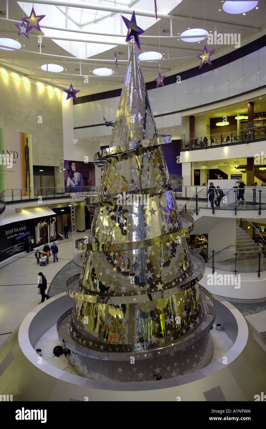 Modern Metal Christmas Tree - Stock photo metal metallic christmas tree inside interior modern light shopping store manchester arndale centre inside shopping mall urb