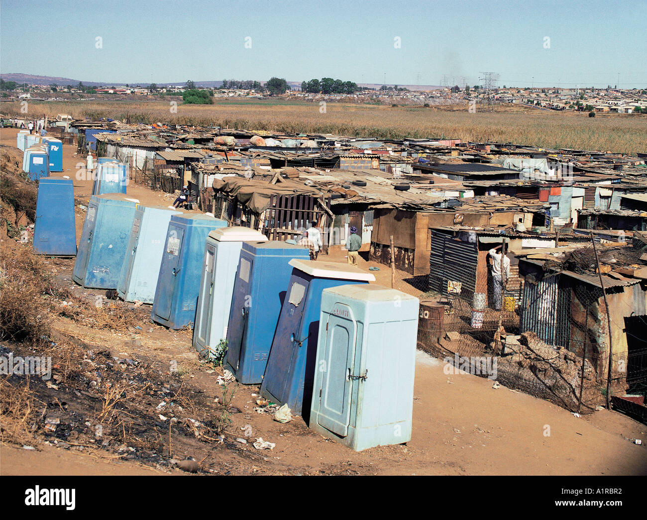 A row of lockable latrines in shanty town area of soweto for Nearby boutiques