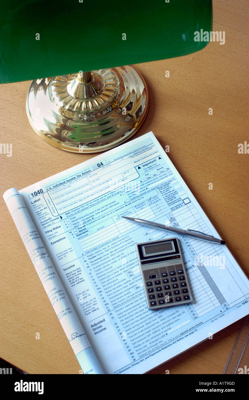 American income tax form 1040 ready to be filled out on desk lamp american income tax form 1040 ready to be filled out on desk lamp calculator falaconquin