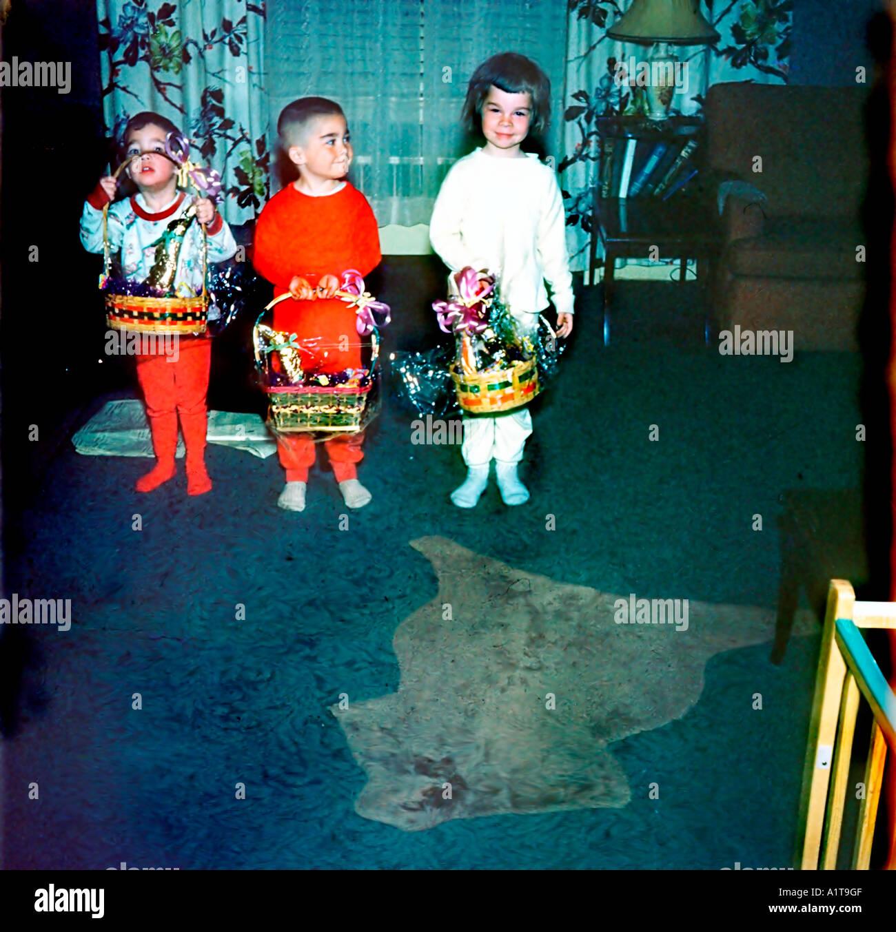 1950s family retro photo children holding easter baskets at home 1950s family retro photo children holding easter baskets at home in living room vintage negle Gallery