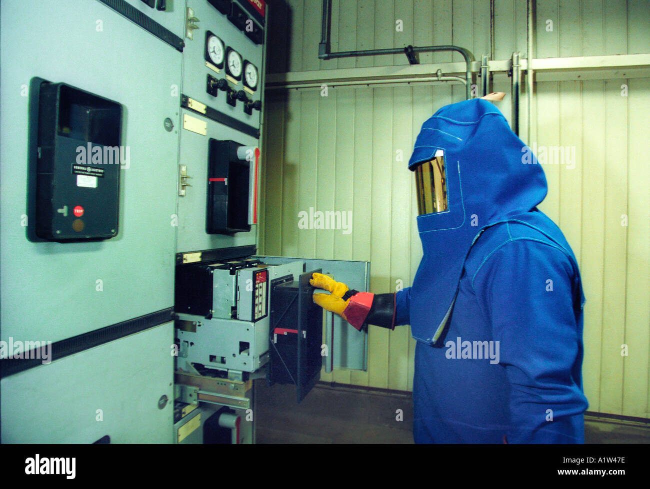 Electrician Works On High Voltage Equipment At Auto Assembly Plant ...