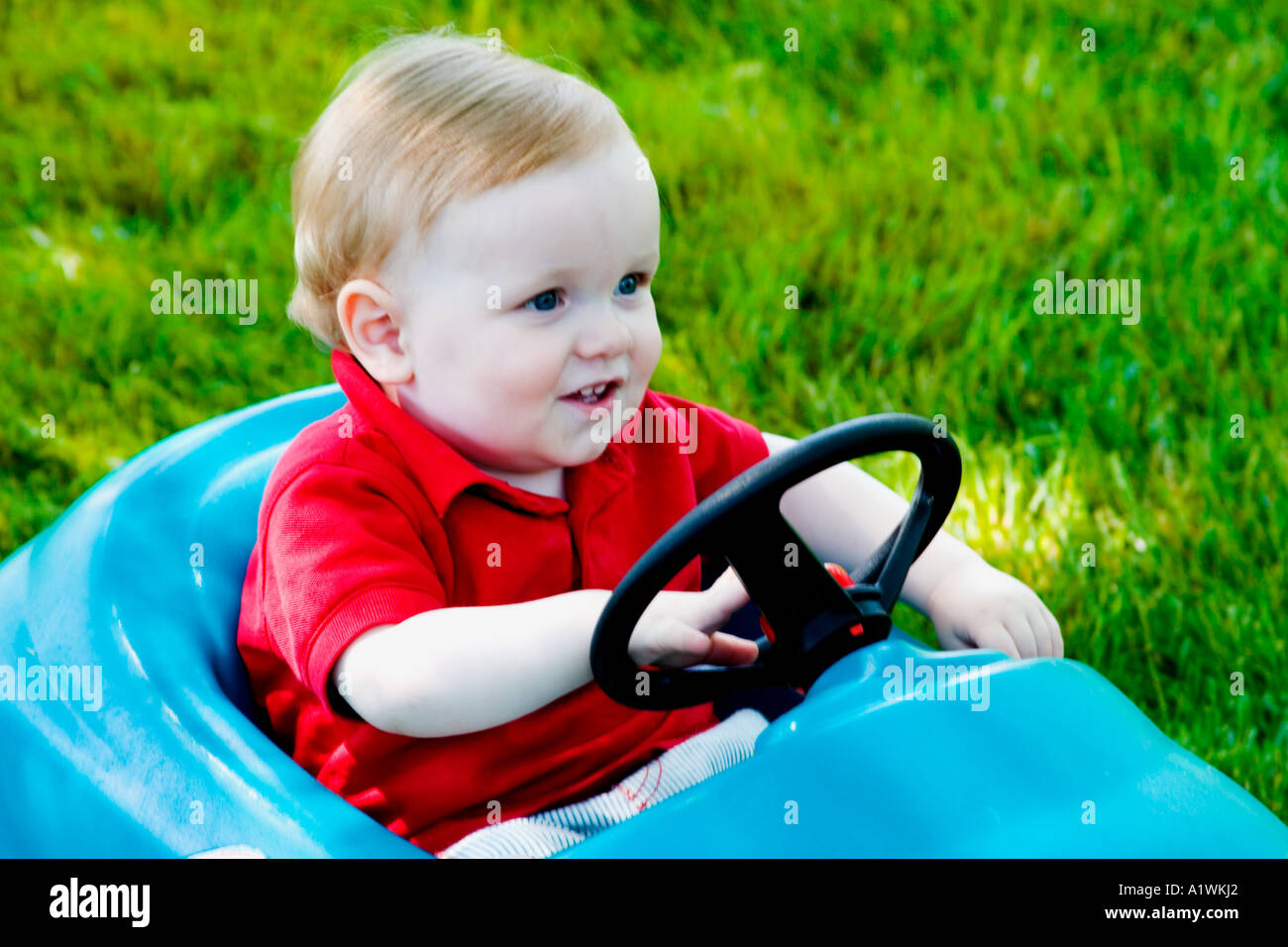 Toy Cars For 1 Year Old Boy : One year old boy riding in a toy car stock photo royalty