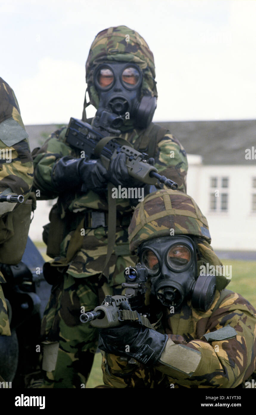 TROOPS POSING WITH CHEMICAL DEFENCE EQUIPMENT WEARING PROTECTIVE ...
