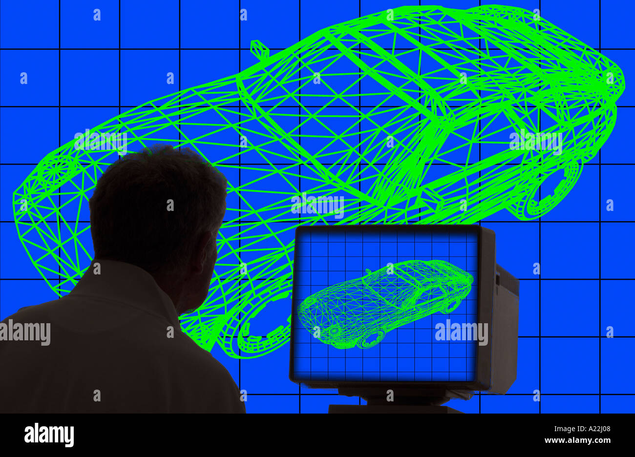 designer studying automobile wire frame design on computer monitor ...