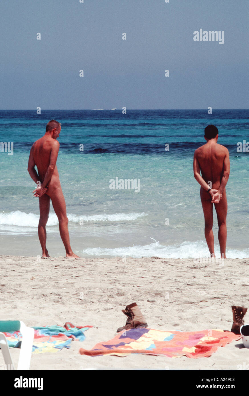 Ibiza Spain Male Couple Standing In Front Of Ocean On Spanish Nudist Beach Scene Platja De Ses Salines