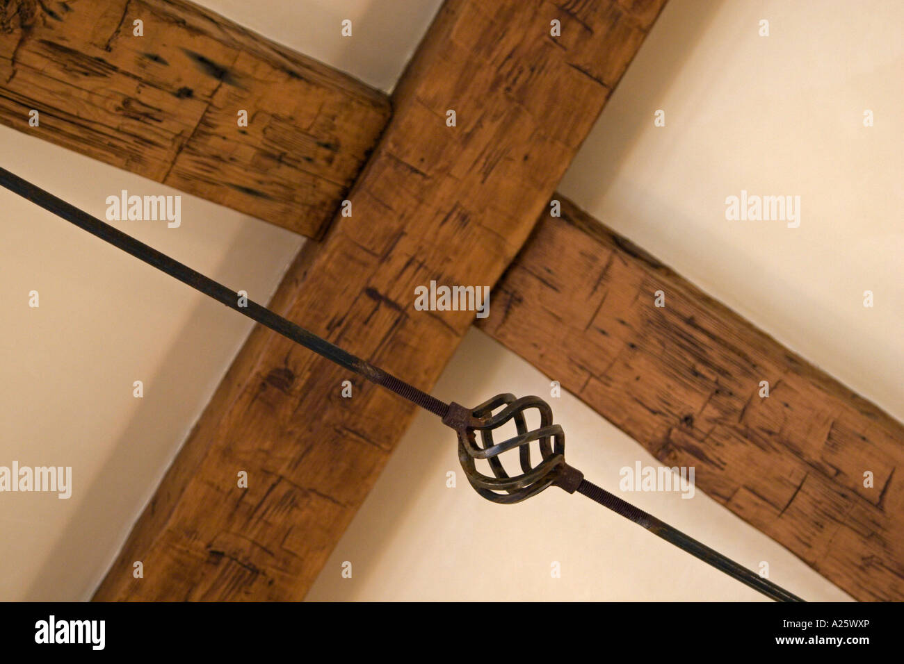 A Wrought Iron Turnbuckle And Open Beam Ceiling In A