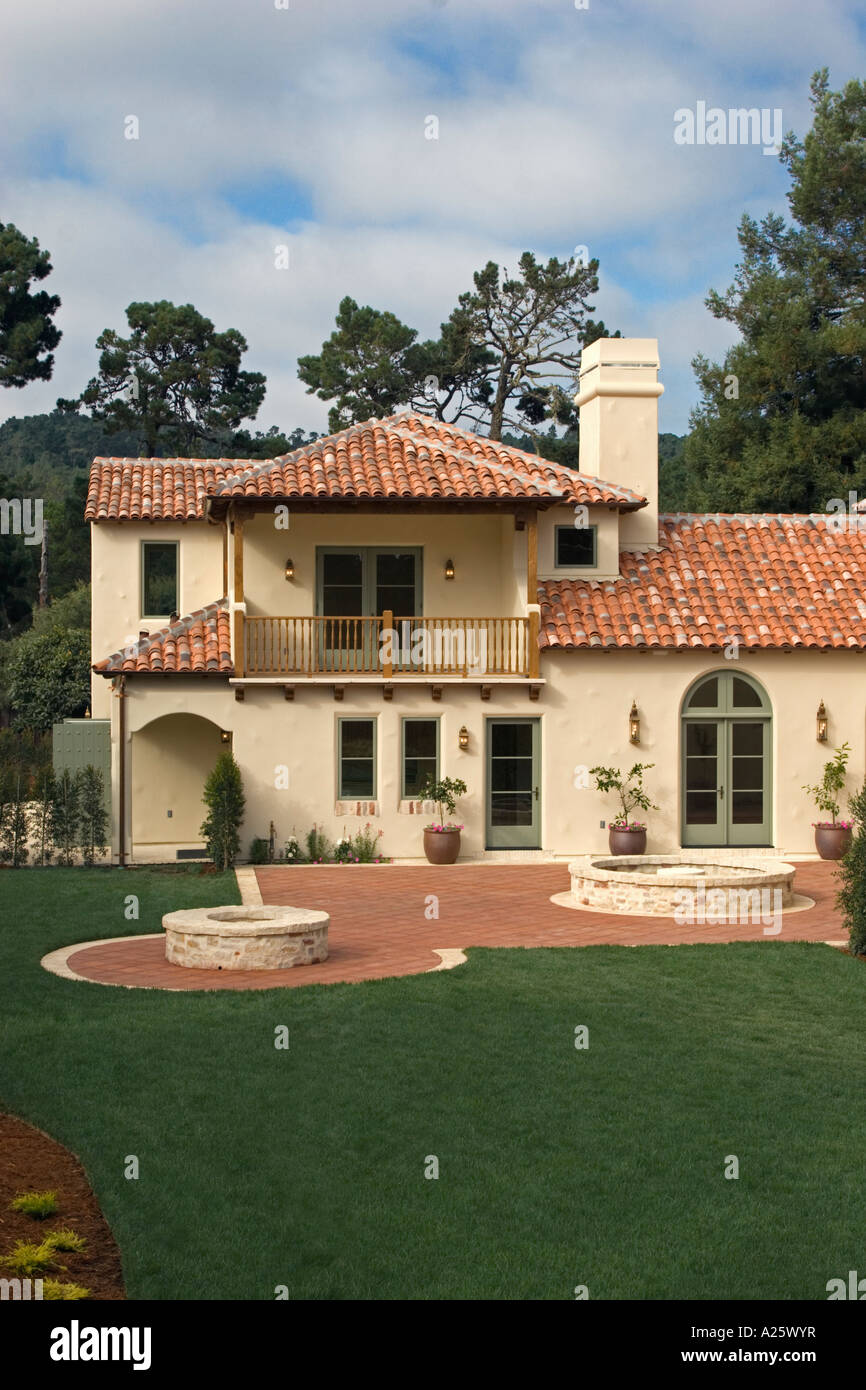 Exterior of a spanish style luxury home with stucco walls for Spanish style roof tiles