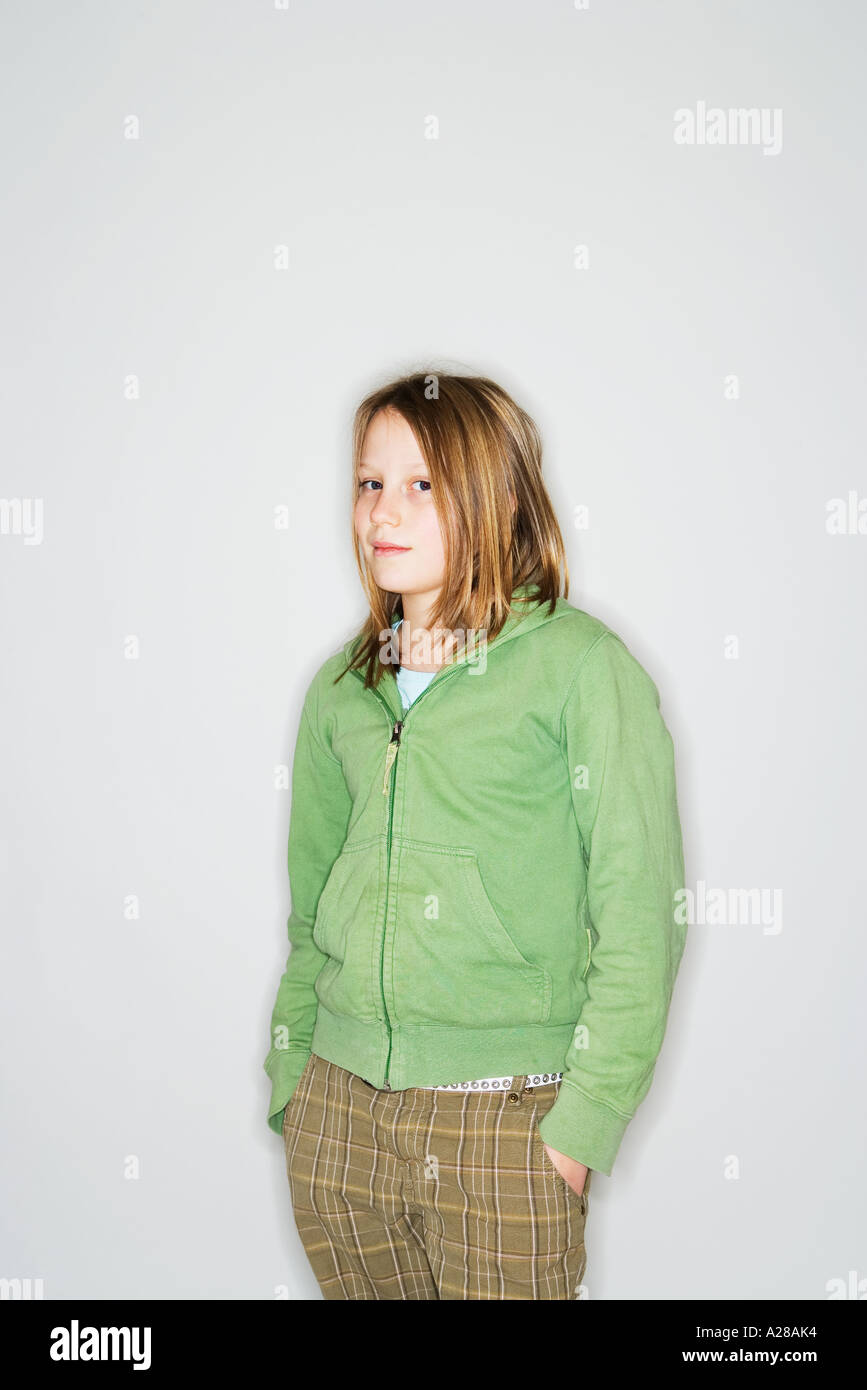 PORTRAIT OF 11 YEAR OLD GIRL STANDING WITH HANDS IN ...