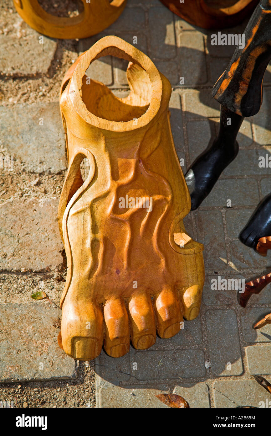 Wood carving of a human adult foot for sale in the craft