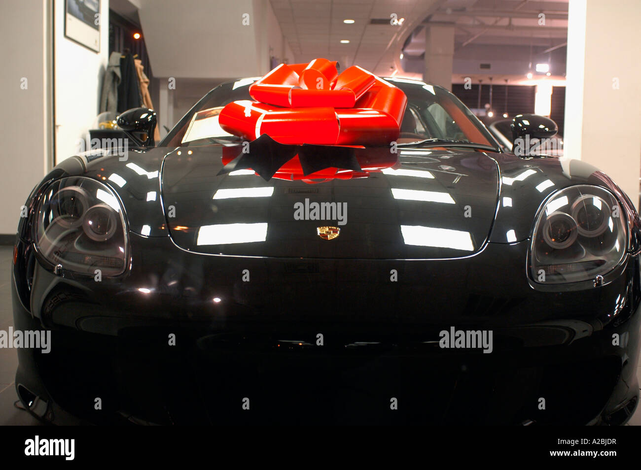 A Black Porsche All Decorated As A Christmas Gift Stock Photo Royalty Free Image 10471042 Alamy