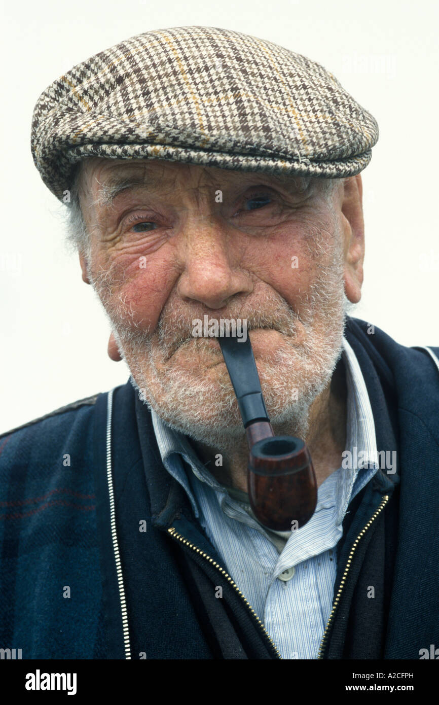 Portrait Of An Old Irishman Smoking His Pipe Stock Photo
