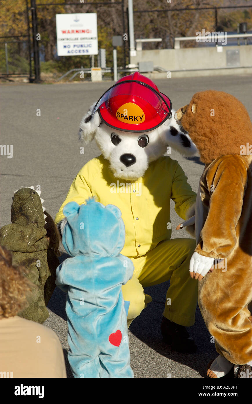 sparky the fire dog with little kids in halloween costumes - Halloween Costume Fire