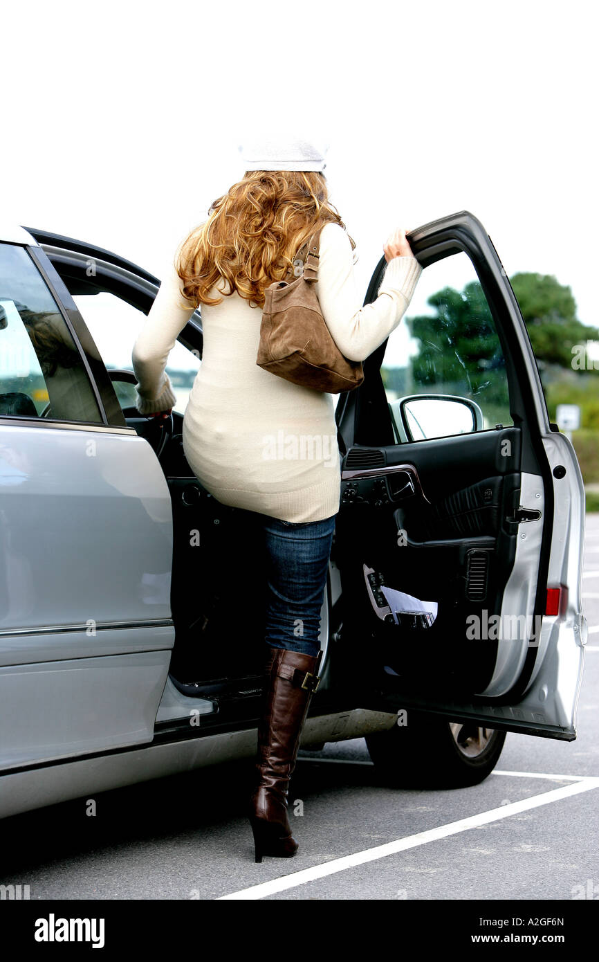 8 Person Car >> Young Woman Entering a Car Model Released Stock Photo, Royalty Free Image: 10516988 - Alamy