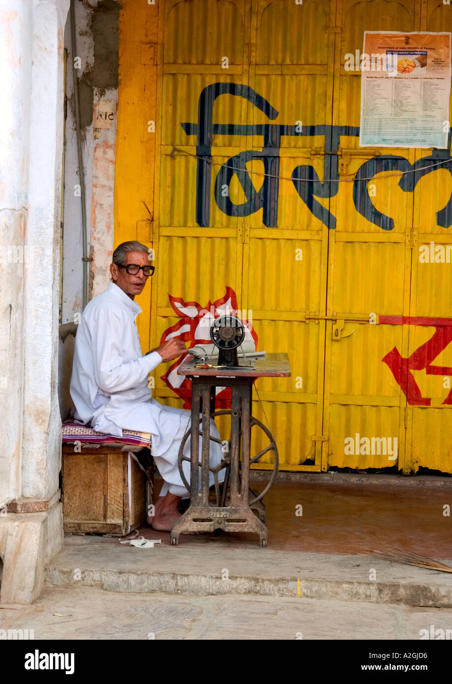 Tailor working at sewing machine rural India Stock Photo, Royalty ...