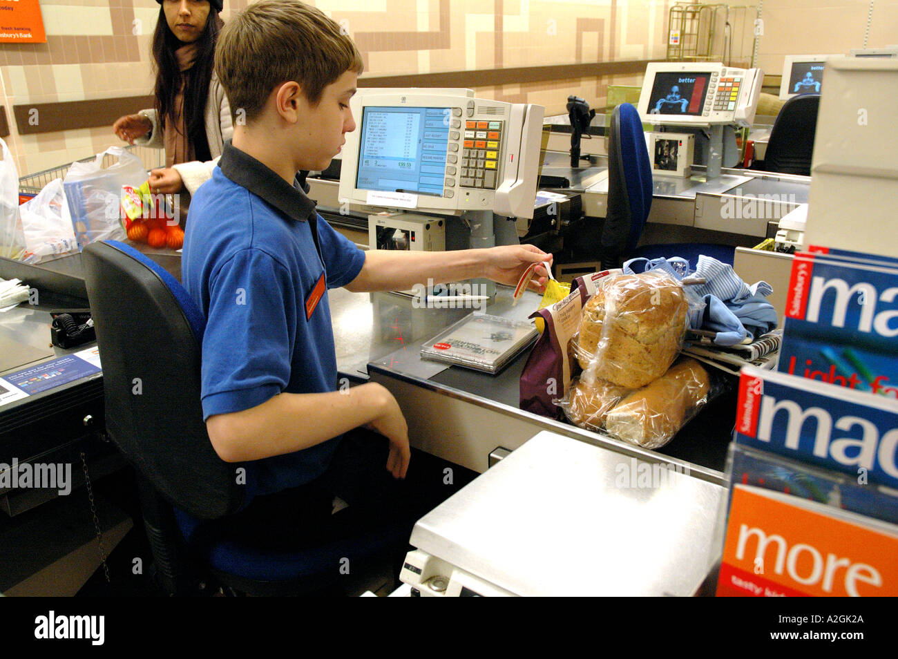 teenage youth working on supermarket till stock photo royalty stock photo teenage youth working on supermarket till