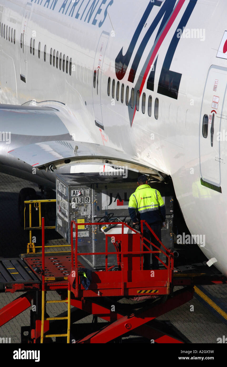 Japan Airlines Boeing 747 aircraft with cargo door open at Melbourne Airport Australia & Japan Airlines Boeing 747 aircraft with cargo door open at ...