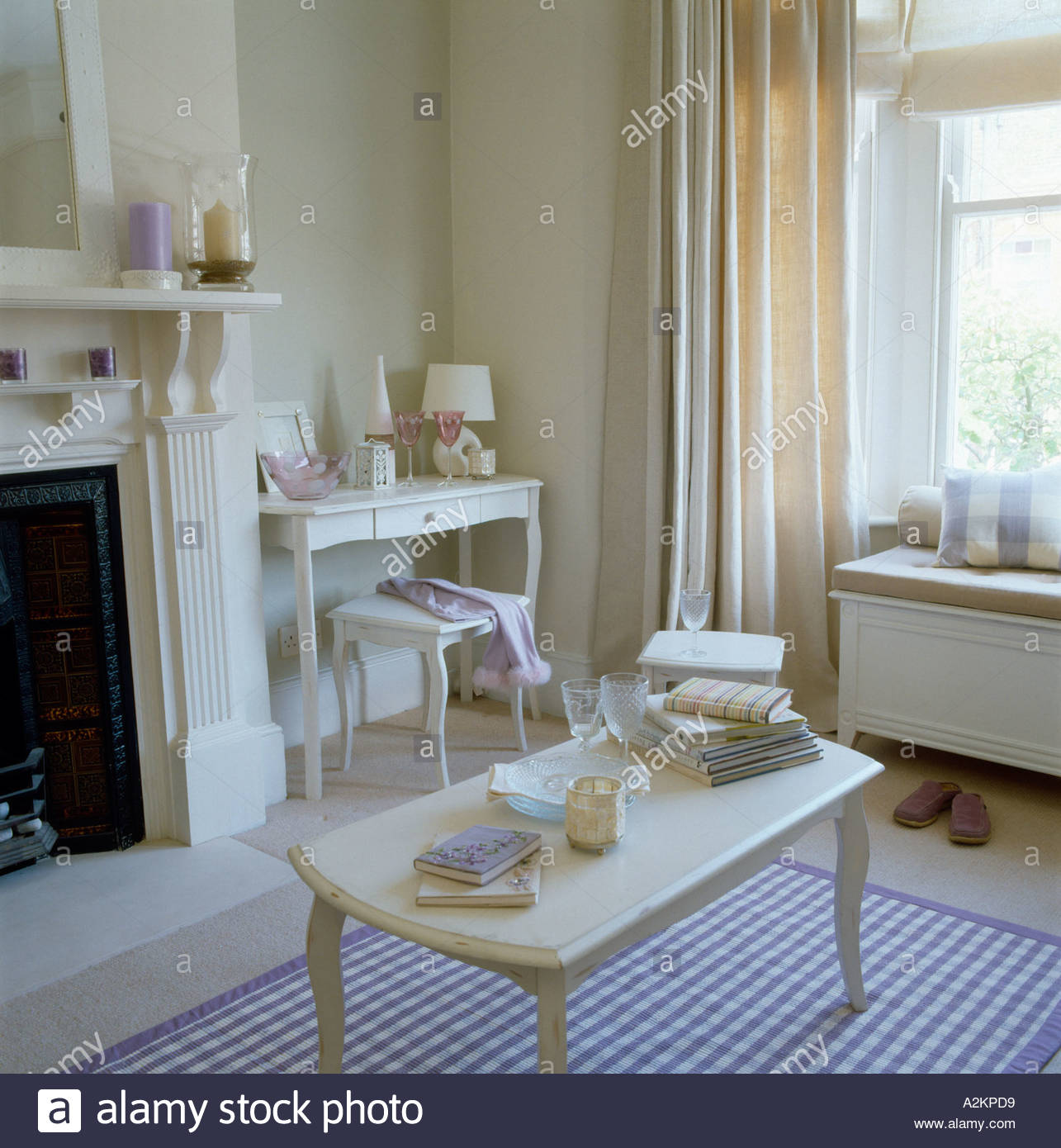Living room decorated in lilac purple and cream colour scheme