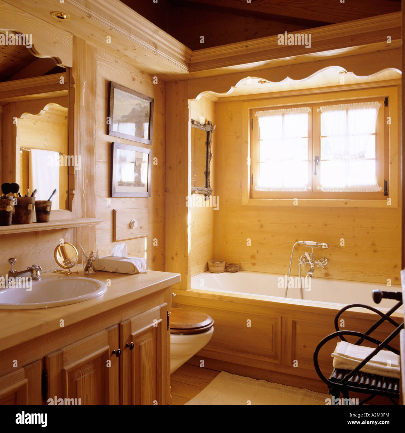 Pine bathroom in traditional mountain chalet Stock Photo