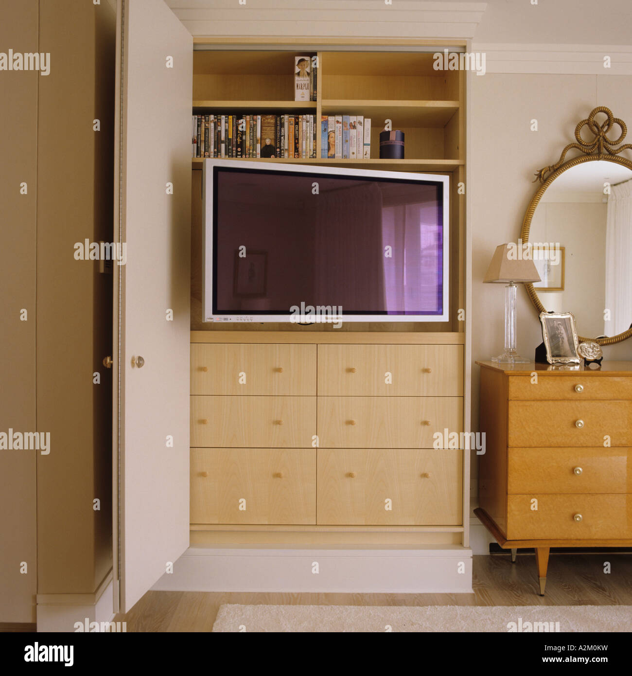 Bedroom dressing table and cupboard - Flat Screen Tv In Cupboard In London Flat With Interior Design By Emily Todhunter Stock