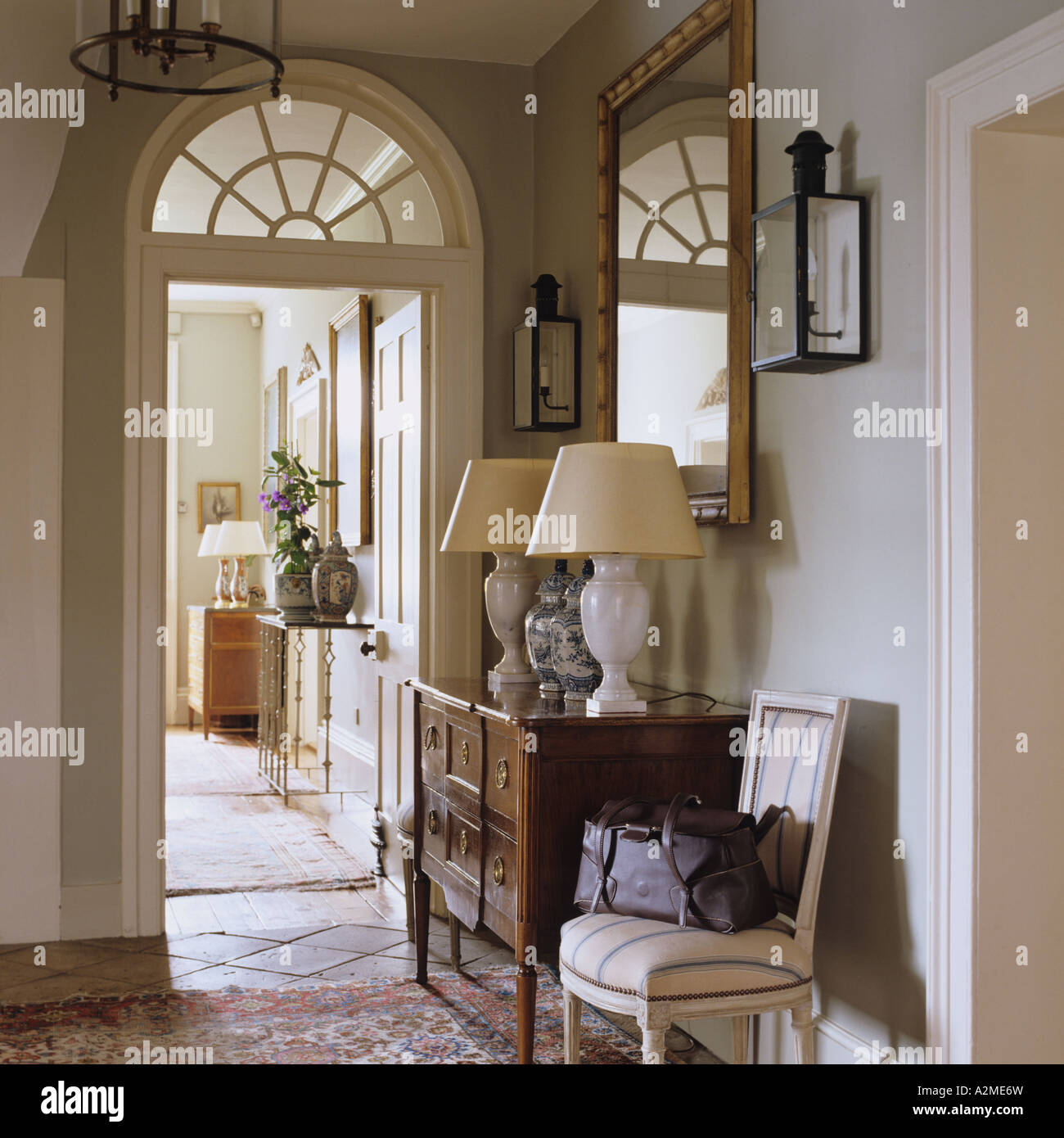 Hallway of english country house with dresser lamps and for Country hallway ideas