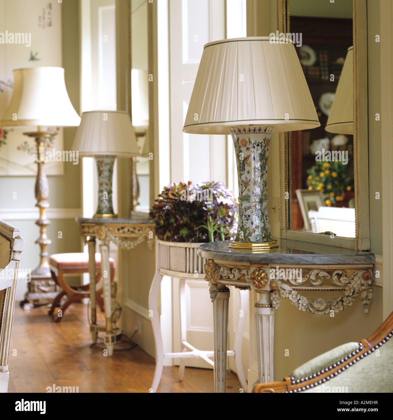 Marble topped console tables with lamps in drawing room of english marble topped console tables with lamps in drawing room of english country house geotapseo Image collections