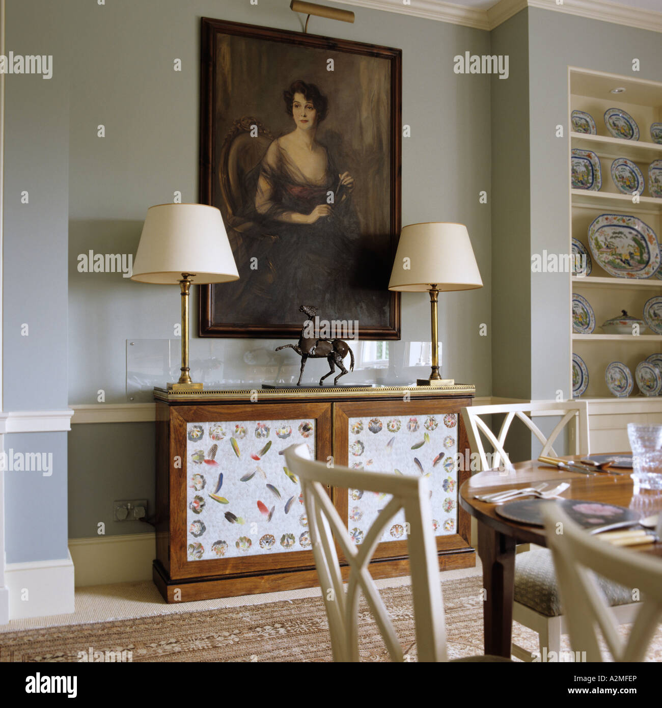 Dining Room With Oil Panting And Lamps In English Country House Dating From  1820s