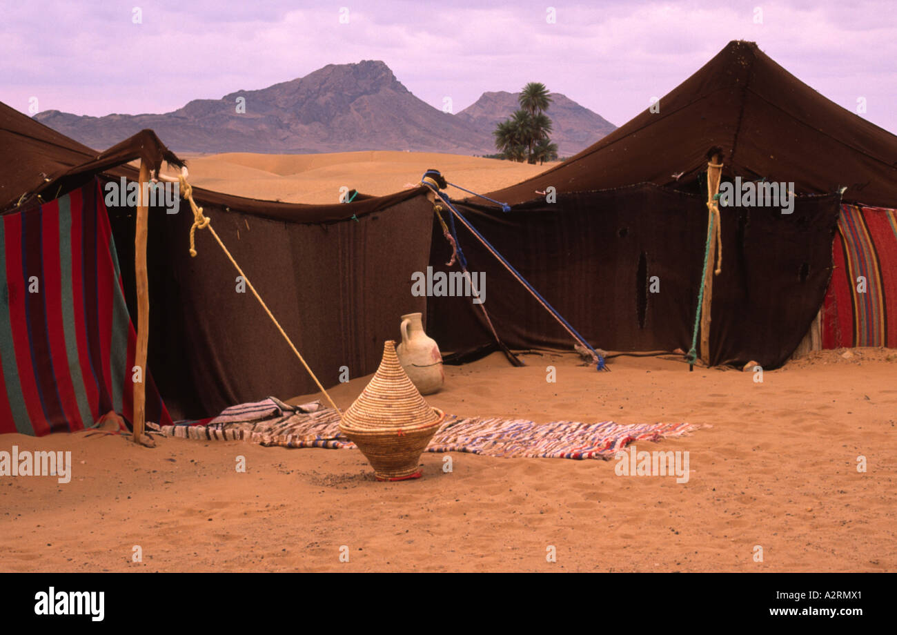 Bedouin tent in Sahara desert Morocco set up for tourists in traditional style of nomadic tribespeople & Bedouin tent in Sahara desert Morocco set up for tourists in ...