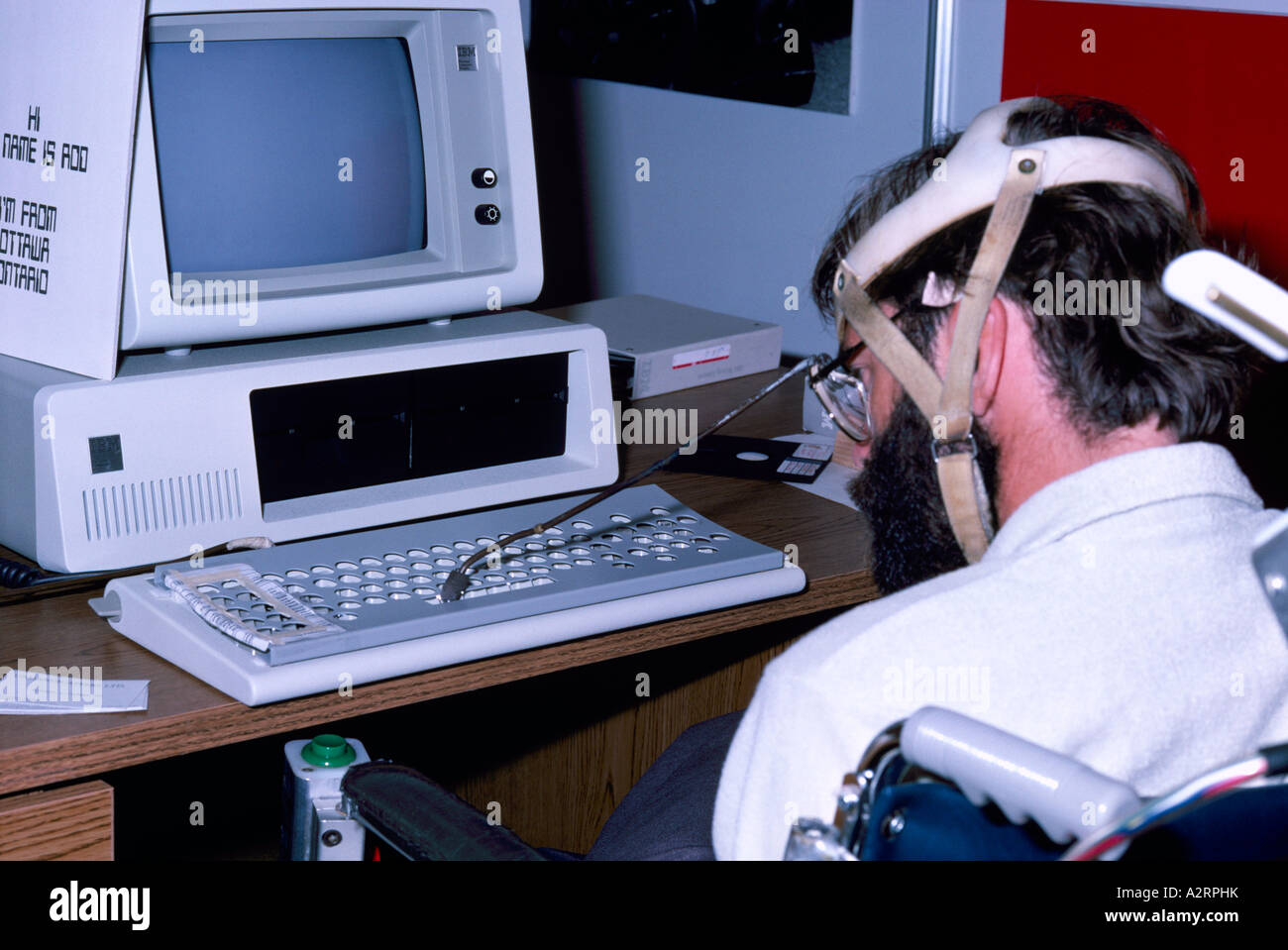 Disabled Man Using Computer By Typing On Keyboard With A