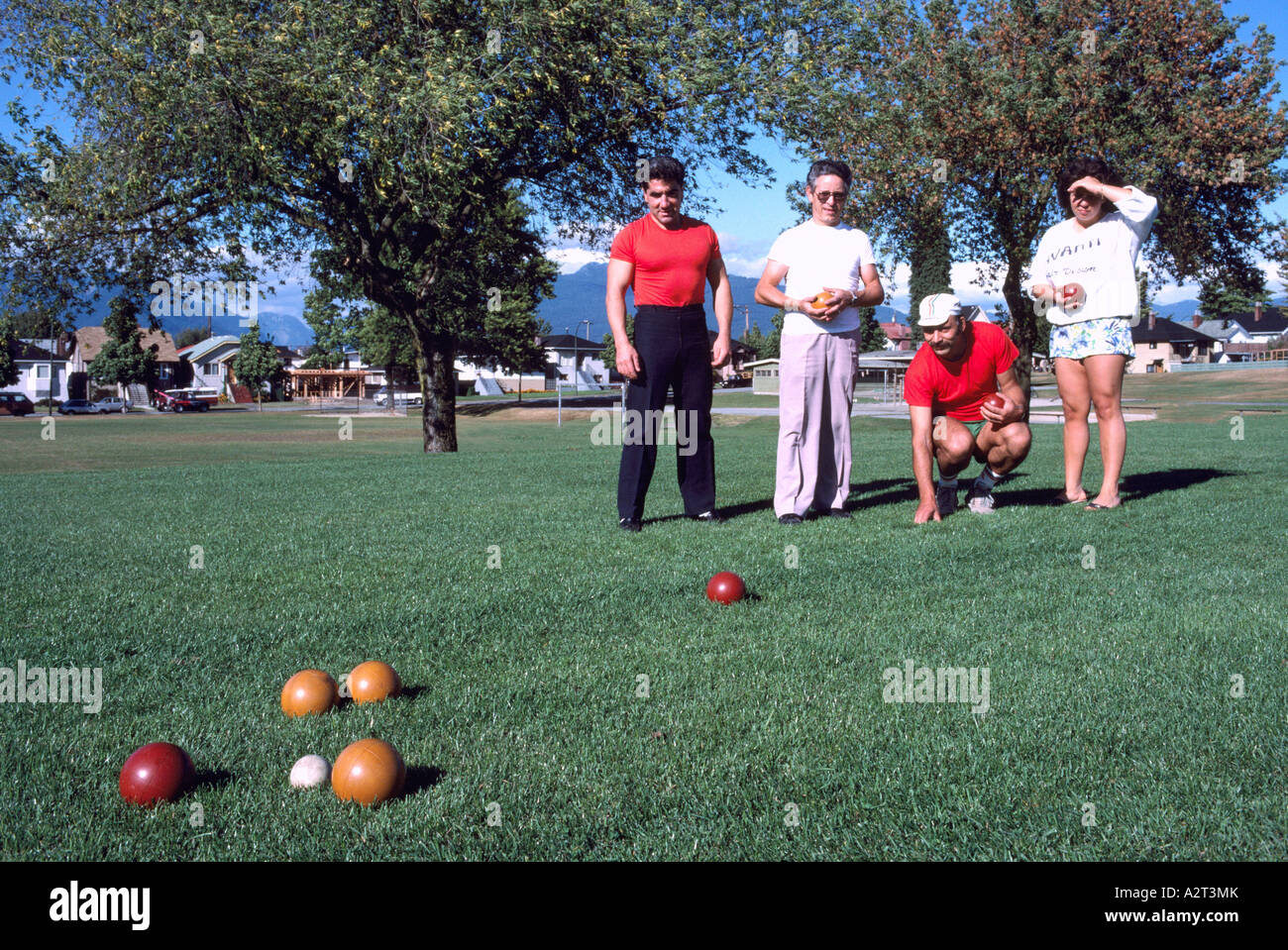 Bocce Players playing the Italian Game of Bocce Ball in a Park in ...