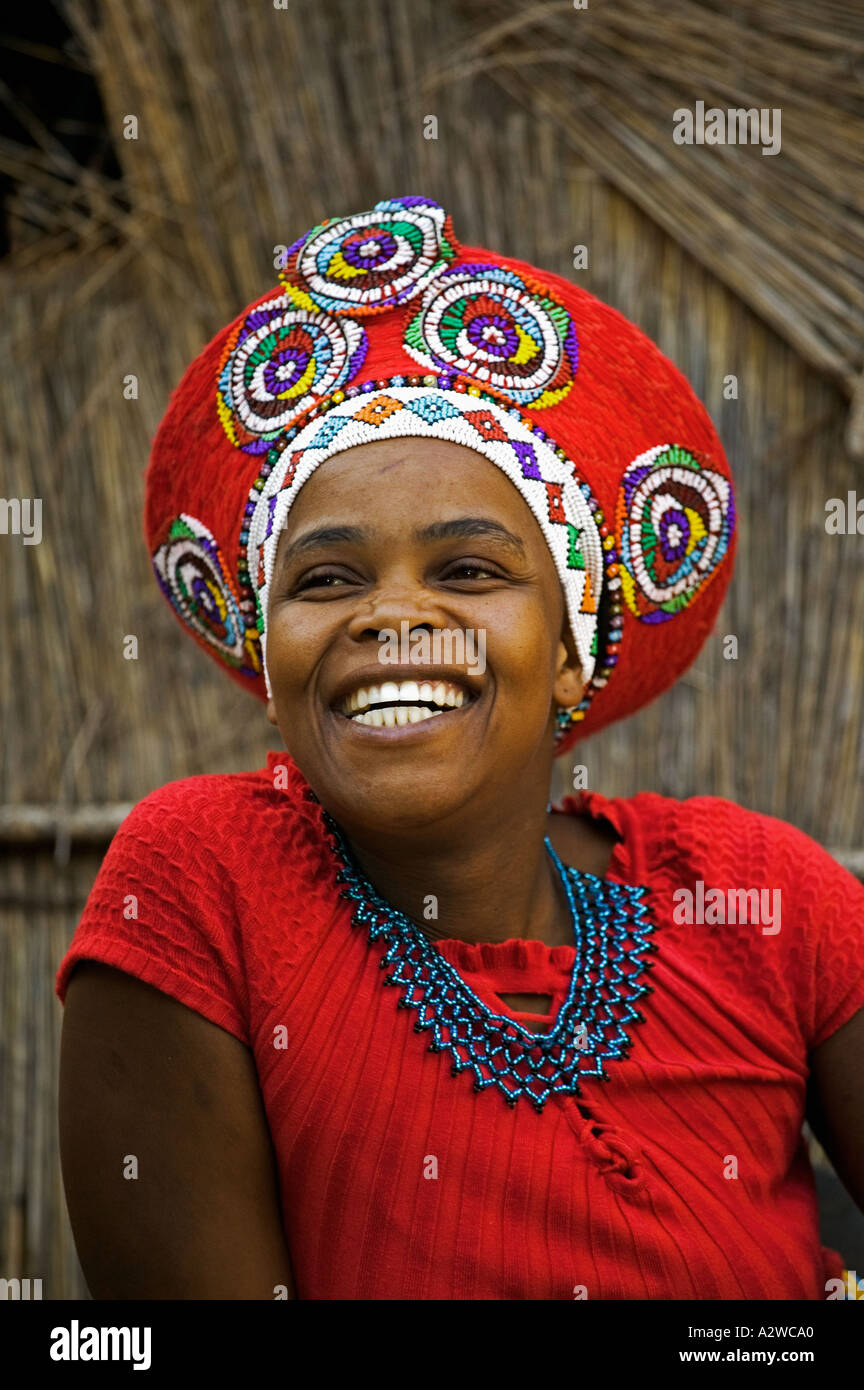 Zulu woman in traditional red headdress of a married woman ... Traditional African Fashion Headdress