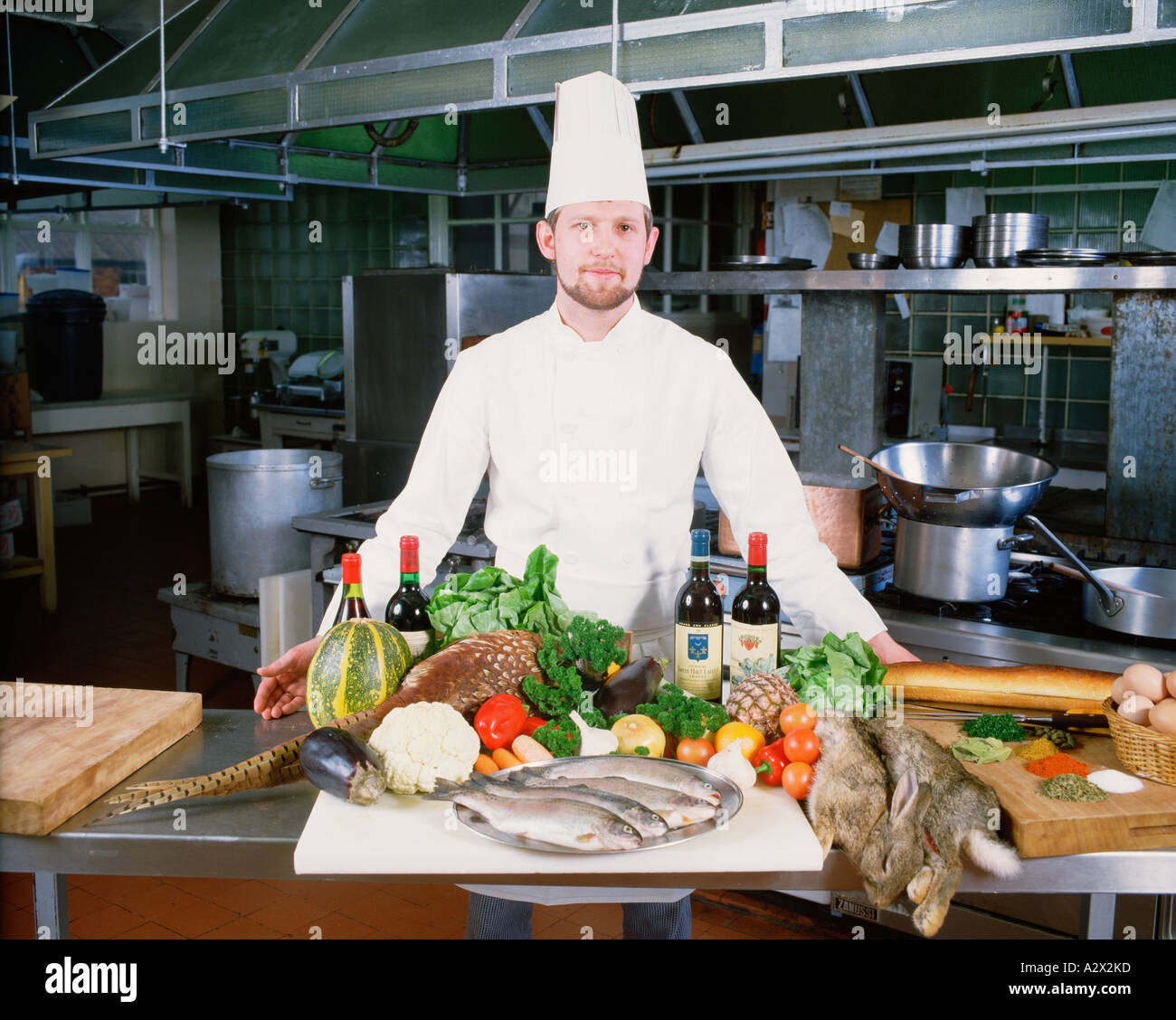 Professional chef in hotel kitchen with display of fresh for Fresh chef kitchen