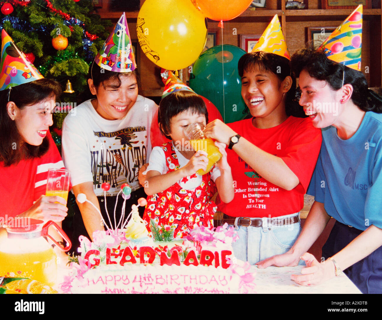 Happy Family At Little Girl Child's 4th Birthday Party